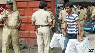 Bihar elections official carries cases of electronic voting material