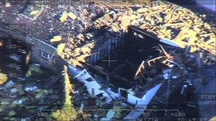 Aerial view of destroyed house