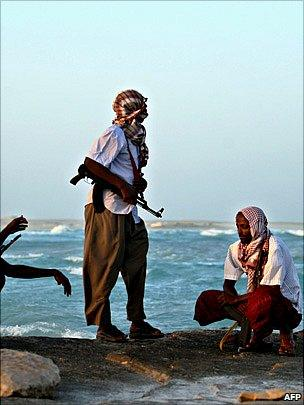 Armed pirates keeping vigil along the coastline at Hobyo town, north-eastern Somalia