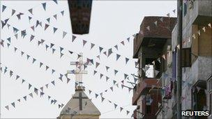 An Egyptian Coptic Orthodox church is seen beneath a decorated lantern in the town of Nagaa Hamady, in Qena, southern Egypt