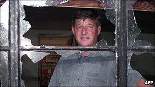 Paul Retzlaff stands in his damaged farm (12 April 2000)