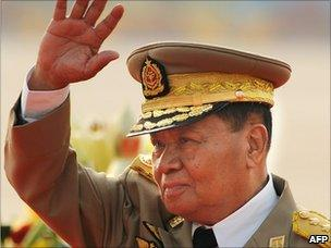 General Than Shwe waves as he reviews troops during a military parade (March 2010)