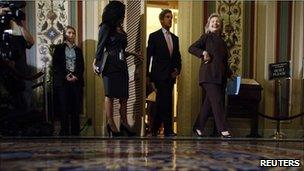 Hillary Clinton and John Kerry walking into a press conference