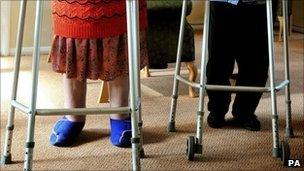 Two women with zimmer frames