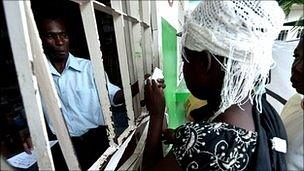 People collect rehydration medicine in Haiti