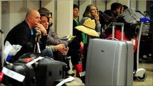Passengers wait at Birmingham Airport after its closure