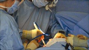 Dr Sumit Goyal carrying out the operation on Steve McAllister