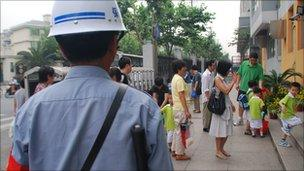 A guard at the entrance to Shanghai's Xiang Yin kindergarten