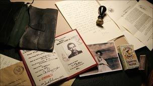 ID card, cigarettes and keepsakes from a fictional sweetheart named Pam, all placed in the corpse's pockets to build up his identity