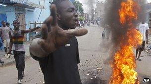 Supporters of Ivory Coast opposition leader Alassane Ouattara protest, 06/12