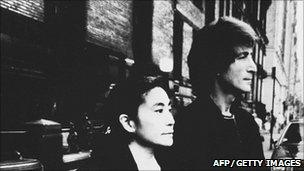 John Lennon and Yoko Ono outside the Dakota building, earlier in 1980