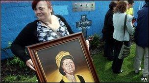 Irene Connolly with a portrait of her mother Joan who was killed by the Army at Ballymurphy in 1971