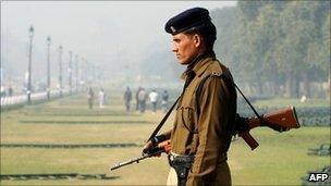 An Indian security official on guard in Delhi on 8 December 2010; Indian cities are on high alert after Tuesday's blast in Varanasi