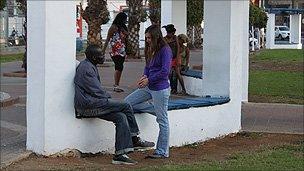 Segal Rosen speaks to a Sudanese man