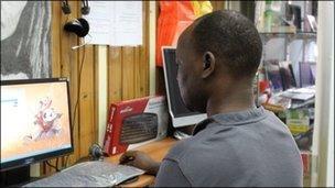 Darfuri man on computer