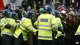 Students and police clash at a protest against tuition fees