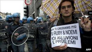 """A protestor holds a placard reading """"We don't believe you anymore"""" in Padova (9 November 2010)"""