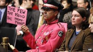 Gay protestor at congressional hearing