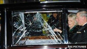 Prince Charles and Camilla are attacked by protesters in their car in London