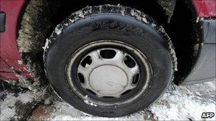 Normal car tyre in the snow