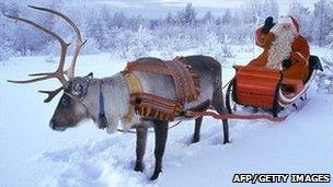 Santa and his reindeer in Finnish Lapland