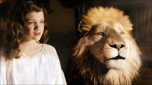 Georgie Henley with Aslan in The Chronicles of Narnia: The Voyage of the Dawn Treader