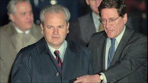 Then Assistant Secretary of State Richard Holbrooke, right, escorts Serbian President Slobodan Milosevic across the tarmac at Wright-Patterson Air Force Base in Dayton, Ohio, on 31 October 1995