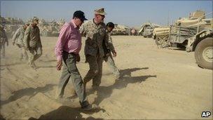 Richard Holbrooke listens to US Maj Gen Richard Mills during a visit to Marjah, south of Kabul, Afghanistan in June 2010