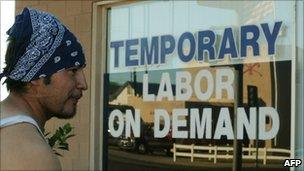 Unemployed man in California reading a job notice