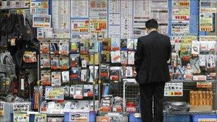 A man outside a Tokyo electronics shop
