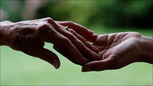 Hands of elderly and young woman
