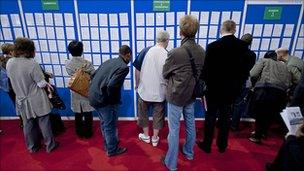Graduates look for job opportunities at a recruitment fair