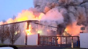 Flames from the fire at the industrial estate.