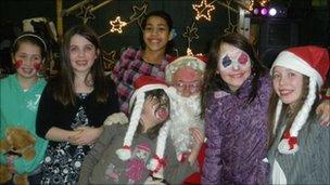 Children with Santa at party