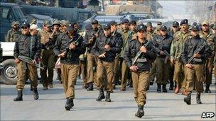 Indian policemen patrol near Srinagar, Indian-administered Kashmir, in November 2010