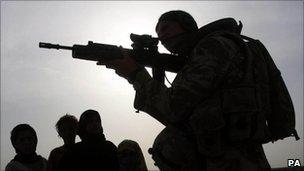British soldier in Iraq alongside civilians