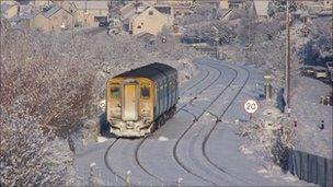 Train making its way through snow near Llandudno Junction, Conwy