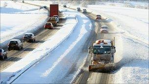 A snow plough makes its way along the A9