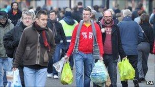 Shoppers in Manchester on Christmas Eve