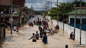 People evacuating homes in Higuerote, Venezuela, on 5 December 2010.