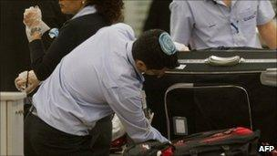 Israeli airport staff check a passenger's luggage at Ben Gurion Airport near Tel Aviv (file image from 13 December)