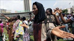 Women take part in a prayer session in Plateau, in Abidjan, 27 December 2010