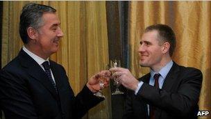 Igor Luksic (R) raises a glass with his predecessor and mentor Milo Djukanovic