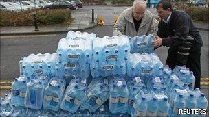 People holding bottled waters