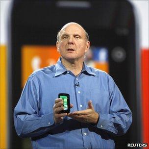 Microsoft CEO Steve Ballmer holds a Windows 7