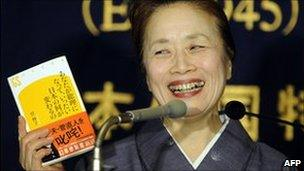 Nobuko Kan, wife of Japan PM Naoto Kan shows her book about her husband, Tokyo, 12 January 2011