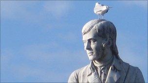Seagull on head of Robert Burns statue