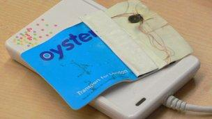 Partially melted Oyster card lying on a card reader