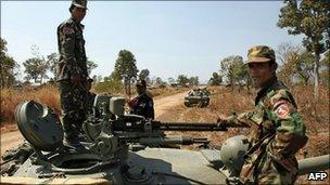 Cambodian soldiers stand on a tank near the Preah Vihear temple in Preah Vihear province, 6 Feb