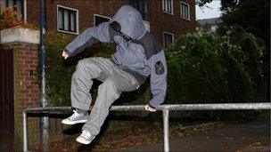 Teenager jumping over barrier